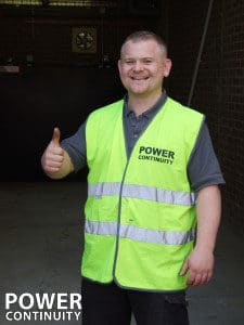 Electrical Engineer with thumb up wearing a Hi-Viz