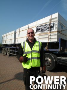 Engineer-delivering-generators-contact-us