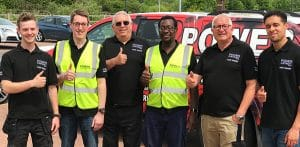 Six Electrical Engineer in front of company vehicle