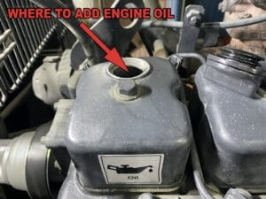 adding engine oil to generator